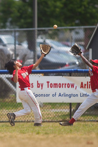 Alex and Alex chasing a deep hit to center field in the top of the 6th inning. The Nationals played a close and exciting game against the Cubs before being outscored in the 6th inning, losing 8-9. They are now 2-1 for the season. 2012 Arlington Little League Baseball, Majors Division. Nationals vs Cubs (21 Apr 2012) (Image taken by Patrick R. Kane on 21 Apr 2012 with Canon EOS-1D Mark III at ISO 200, f2.8, 1/3200 sec and 300mm)