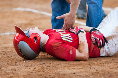 Christopher on the ground after being leveled by the 1st baseman who ran to the bag and over Christopher to make the out. It was a close play, and from my vantage point, an incorrect call. The Nationals finished the regular season tied for first place in the American League, but were simply no match for the Athletics tonight. Having split their regular season games, we expected a competitive playoff game, but the Athletics started their ace pitcher and came to hit, handing the Nationals a 2-14 loss. Though the Nationals were eliminated from the playoffs earlier than expected, they had a great season. CONGRATULATIONS to the Nats for taking home the AL pennant. 2012 Arlington Little League Baseball, Majors Division. (Image taken by Patrick R. Kane on 12 Jun 2012 with Canon EOS-1D Mark III at ISO 3200, f4.0, 1/640 sec and 210mm)