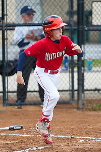 Luke hits a single up the middle in the top of the 2nd inning. The Nationals almost blew a big lead, but managed to hold off the Brewers to win 9-7. They are now 3-2 for the season. 2012 Arlington Little League Baseball, Majors Division. Nationals vs Brewers (26 Apr 2012) (Image taken by Patrick R. Kane on 26 Apr 2012 with Canon EOS-1D Mark III at ISO 800, f2.8, 1/1600 sec and 200mm)