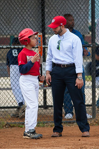 Coach and Isaiah in the top of the 2nd inning. The Nationals almost blew a big lead, but managed to hold off the Brewers to win 9-7. They are now 3-2 for the season. 2012 Arlington Little League Baseball, Majors Division. Nationals vs Brewers (26 Apr 2012) (Image taken by Patrick R. Kane on 26 Apr 2012 with Canon EOS-1D Mark III at ISO 800, f2.8, 1/3200 sec and 200mm)