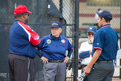 Coaches Coop and Fox pre-game with the umpires. The Nationals almost blew a big lead, but managed to hold off the Brewers to win 9-7. They are now 3-2 for the season. 2012 Arlington Little League Baseball, Majors Division. Nationals vs Brewers (26 Apr 2012) (Image taken by Patrick R. Kane on 26 Apr 2012 with Canon EOS-1D Mark III at ISO 800, f2.8, 1/800 sec and 142mm)
