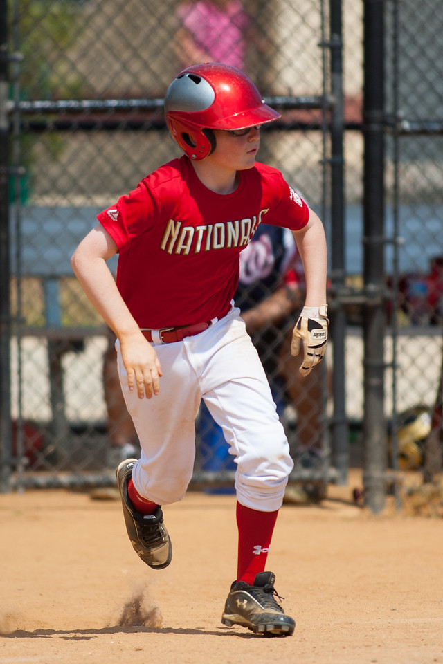 Christopher hits a single to center field in the bottom of the 3rd inning. The Nationals played a close and exciting game against the Cubs before being outscored in the 6th inning, losing 8-9. They are now 2-1 for the season. 2012 Arlington Little League Baseball, Majors Division. Nationals vs Cubs (21 Apr 2012) (Image taken by Patrick R. Kane on 21 Apr 2012 with Canon EOS-1D Mark III at ISO 200, f2.8, 1/5000 sec and 300mm)