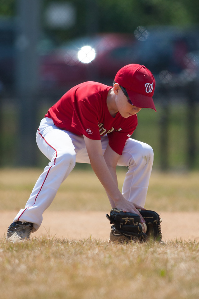 Toby fielding a hit near 1st base for the out in the top of the 3rd inning. The Nationals played a close and exciting game against the Cubs before being outscored in the 6th inning, losing 8-9. They are now 2-1 for the season. 2012 Arlington Little League Baseball, Majors Division. Nationals vs Cubs (21 Apr 2012) (Image taken by Patrick R. Kane on 21 Apr 2012 with Canon EOS-1D Mark III at ISO 200, f2.8, 1/2500 sec and 300mm)