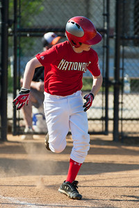 Christopher hits into the infield and is thrown out at 1st base in the top of the 1st inning. The Nationals played a close game against the Orioles before pulling away in the top of the 6th inning for a 5-2 win. They finished the regular season with a 12-6 record. 2012 Arlington Little League Baseball, Majors Division. Nationals vs Orioles (09 Jun 2012) (Image taken by Patrick R. Kane on 09 Jun 2012 with Canon EOS-1D Mark III at ISO 400, f4.0, 1/1600 sec and 280mm)