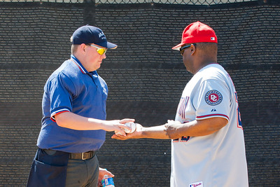 Coach Coop handing the game balls to Sean. The Nationals struggled on both offense and defense in a 2-11 loss to the Orioles. They are now 7-4 for the season. 2012 Arlington Little League Baseball, Majors Division. Nationals vs Orioles (19 May 2012) (Image taken by Patrick R. Kane on 19 May 2012 with Canon EOS-1D Mark III at ISO 400, f8.0, 1/160 sec and 110mm)