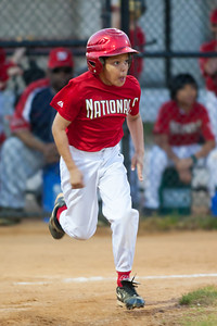 Isaiah hits a single in the bottom of the 1st inning. The Nationals won their second game in a row to start the season with an 11-0 victory over the Twins. 2012 Arlington Little League Baseball, Majors Division. Nationals vs Twins (19 Apr 2012) (Image taken by Patrick R. Kane on 19 Apr 2012 with Canon EOS-1D Mark III at ISO 1600, f2.8, 1/250 sec and 300mm)