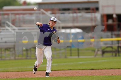 Brownsburg high school third baseman Michael Oliger  (19) makes the throw to first for the out during the game between Zionsville vs Brownsburg at Brownsburg High School in Brownsburg,IN. (Jeff Brown/Flyer Photo)