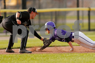 Zionsville high school third baseman Chad Garisek (3) put the tag on Brownsburg high school shortstop Luis Escalante  (13) for the out during the game between Zionsville vs Brownsburg at Brownsburg High School in Brownsburg,IN. (Jeff Brown/Flyer Photo)