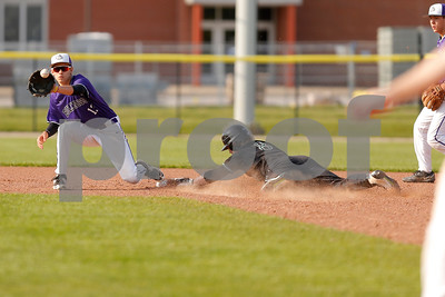 Brownsburg high school shortstop Luis Escalante  (13) makes the catch as Zionsville high school base runner Tyler Milby (8) slides safely into second during the game between Zionsville vs Brownsburg at Brownsburg High School in Brownsburg,IN. (Jeff Brown/Flyer Photo)