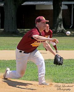 Baseball on way to plate.