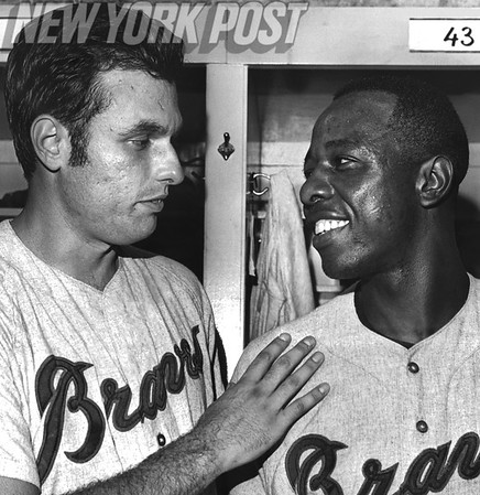 "Henry ""Hank"" Aaron swaps congratulations with pitcher Milt Pappas after a win. 1968"