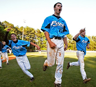 From left, Alex Hegner, Ryan Ussery, and Jake Montgomery celebrate as they make their way towards their Greyhounds fans after winning the state championship title on May 30, 2009.