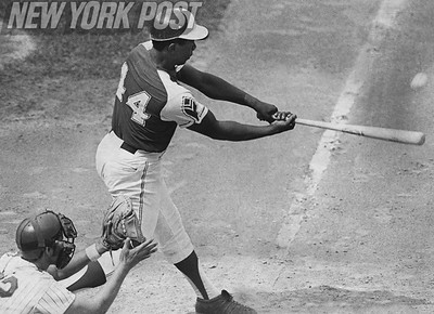 Hank Aaron hits his 696th homerun against the Mets. 1973