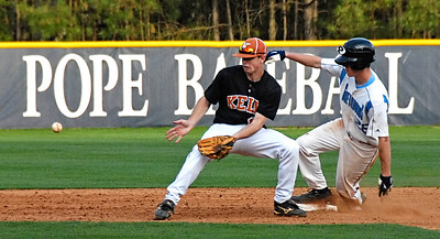 Pope's Alex Kviklys (28) makes it into second safely before the ball reaches Kell's Austin Petrik on March 24, 2010.