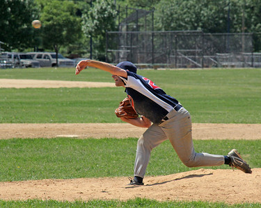 Baseball pitcher at Eisenhower Park. Ball is on the way.