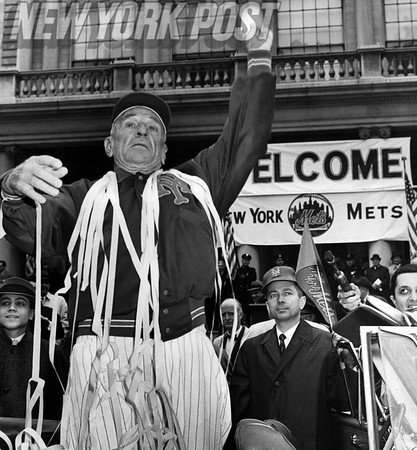 New York Mets Manager Casey Stengel throws a souvenir baseball at a parade. 1962