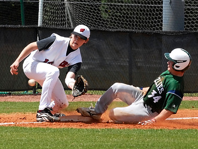 Creekview's Brandon Beans safely slides into third as Walker's Stephen Moore waits for the ball.