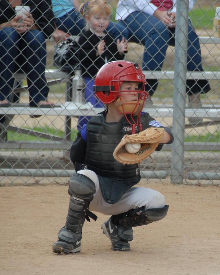 Andrew catching baseball.