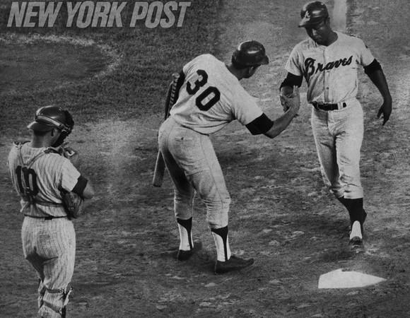 Orlando Cepeda welcomes Hank Aaron home after home run blast. 1970