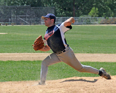 "Baseball pitcher at Eisenhower Park in ""full extension"". My arm sure won't bend that far. Wow. This pitcher was very good."