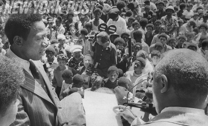 """Henry """"Hank"""" Aaron looked upon by a crowd of young admirers. 1974"""