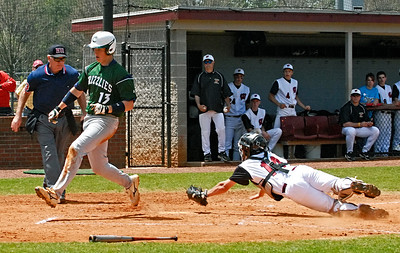 Creekview's Christian Van Camp safely crosses homeplate as Walker's catcher Tyler Collins dives to apply the tag.