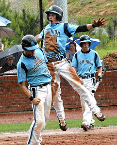 Mitch Gaddis (10) shares his excitement with teammate Derrick Workman as they both score after a singe hit against First Presbyterian Day School on May 16, 2009.