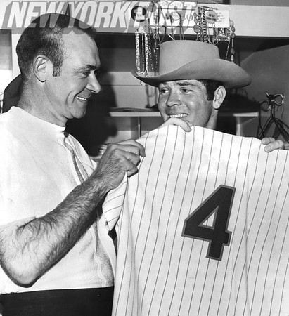 Don Cardwell helps display Ron Swoboda's #4 Jersey. 1969
