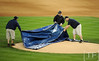 Oct 17, 2012; Detroit, MI, USA; Members of the grounds crew cover the mound with a tarp as incoming inclement weather delays the start of game four of the 2012 ALCS between the New York Yankees and the Detroit Tigers at Comerica Park.   Mandatory Credit: Tim Fuller-USA TODAY Sports