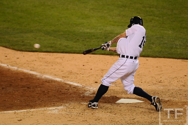 Oct 13, 2011; Detroit, MI, USA; Detroit Tigers third baseman Brandon Inge (15) hits a single in the eighth inning of game five of the 2011 ALCS against the Texas Rangers at Comerica Park.  Mandatory Credit: Tim Fuller-US PRESSWIRE