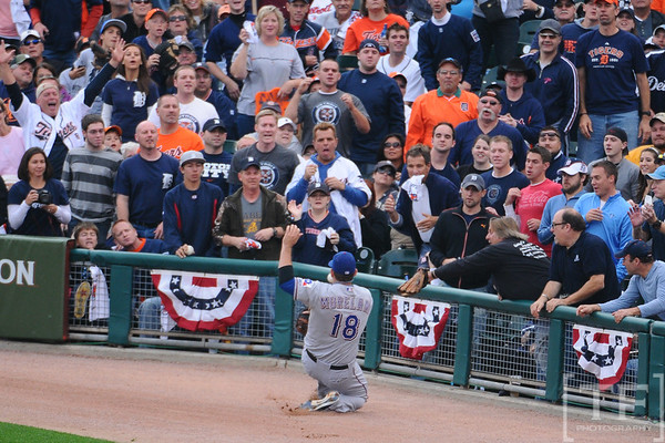 Oct 13, 2011; Detroit, MI, USA; Texas Rangers first baseman Mitch Moreland (18) attempts to catch a foul ball  in the third inning of game five of the 2011 ALCS against the Detroit Tigers at Comerica Park.  Mandatory Credit: Tim Fuller-US PRESSWIRE