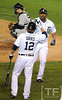 Oct 16, 2012; Detroit, MI, USA; Detroit Tigers designated hitter Delmon Young (right) is congratulated by outfielder Andy Dirks (12) after hitting a solo home run against the New York Yankees in the fourth inning during game three of the 2012 ALCS at Comerica Park.  Mandatory Credit: Tim Fuller-USA TODAY Sports