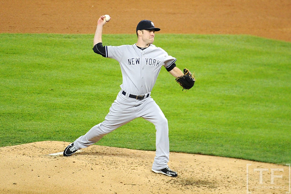 Oct 16, 2012; Detroit, MI, USA; New York Yankees relief pitcher David Phelps throws a pitch against the Detroit Tigers in the 4th inning during game three of the 2012 ALCS at Comerica Park.  Mandatory Credit: Tim Fuller-USA TODAY Sports