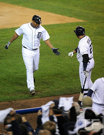 Oct 16, 2012; Detroit, MI, USA; Detroit Tigers designated hitter Delmon Young (left) is congratulated by teammate Jhonny Peralta (27) after hitting a solo home run against the New York Yankees in the fourth inning during game three of the 2012 ALCS at Comerica Park.  Mandatory Credit: Tim Fuller-USA TODAY Sports
