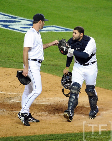 Oct 16, 2012; Detroit, MI, USA; Detroit Tigers catcher Alex Avila (right) is congratulated by starting pitcher Justin Verlander (left) after catching a pop up by New York Yankees catcher Russell Martin (not pictured) in the 2nd inning during game three of the 2012 ALCS at Comerica Park.  Mandatory Credit: Tim Fuller-USA TODAY Sports