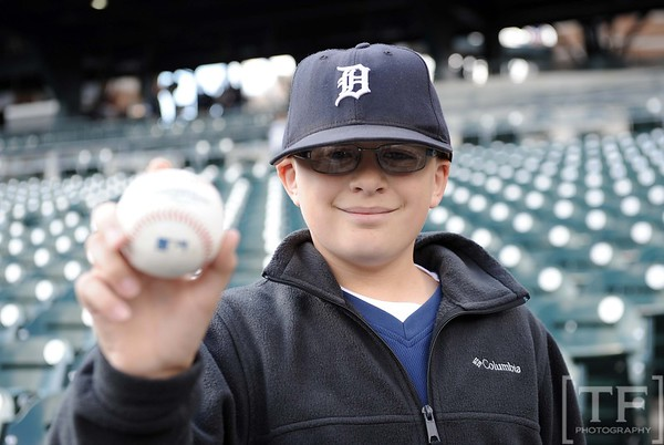 Oct 18, 2012; Detroit, MI, USA; New York Yankees fan Payton Stark holds up a baseball before game four of the 2012 ALCS against the Detroit Tigers at Comerica Park.   Mandatory Credit: Tim Fuller-USA TODAY Sports