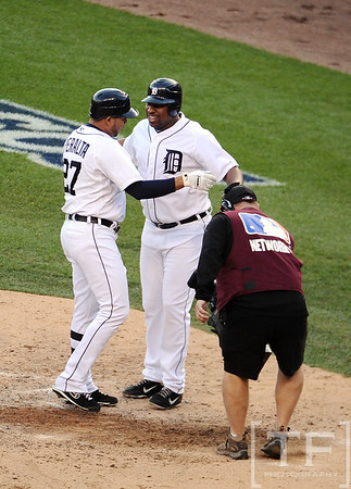 Oct 18, 2012; Detroit, MI, USA; Detroit Tigers shortstop Jhonny Peralta (27) celebrates with designated hitter Delmon Young (right) after hitting a two-run home run against the New York Yankees during game four of the 2012 ALCS at Comerica Park.   Mandatory Credit: Tim Fuller-USA TODAY Sports