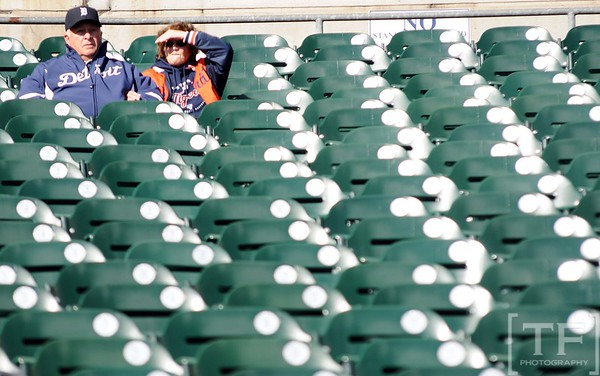 Oct 18, 2012; Detroit, MI, USA; Detroit Tigers fans shield their eyes from the sun as they sit in the stands before game four of the 2012 ALCS against the New York Yankees at Comerica Park.   Mandatory Credit: Tim Fuller-USA TODAY Sports