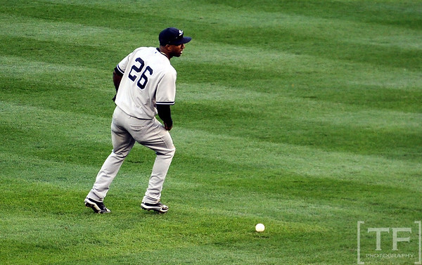 Oct 18, 2012; Detroit, MI, USA; New York Yankees shortstop Eduardo Nunez reacts after committing a fielding error on a ball hit by Detroit Tigers third baseman Miguel Cabrera (not pictured) in the fifth inning during game four of the 2012 ALCS at Comerica Park.   Mandatory Credit: Tim Fuller-USA TODAY Sports