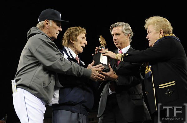 Oct 18, 2012; Detroit, MI, USA; American League honorary president Jackie Autry (right) presents Detroit Tigers manager Jim Leyland (left), owner Mike Ilitch (second from left), and general manager Dave Dombrowski with the American League championship trophy after game four of the 2012 ALCS against the New York Yankees at Comerica Park.  The Tigers won 8-1 to sweep the series and advance to the World Series.  Mandatory Credit: Tim Fuller-USA TODAY Sports