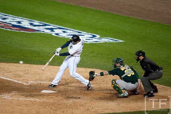 Oct 6, 2012; Detroit, MI, USA; Detroit Tigers catcher Alex Avila (13) hits a single during the seventh inning of game one of the 2012 ALDS against the Oakland Athletics at Comerica Park.  Mandatory Credit: Tim Fuller-US PRESSWIRE