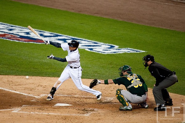 Oct 6, 2012; Detroit, MI, USA; Detroit Tigers left fielder Quintin Berry (52) hits a RBI single during the third inning of game one of the 2012 ALDS against the Oakland Athletics at Comerica Park.  Mandatory Credit: Tim Fuller-US PRESSWIRE