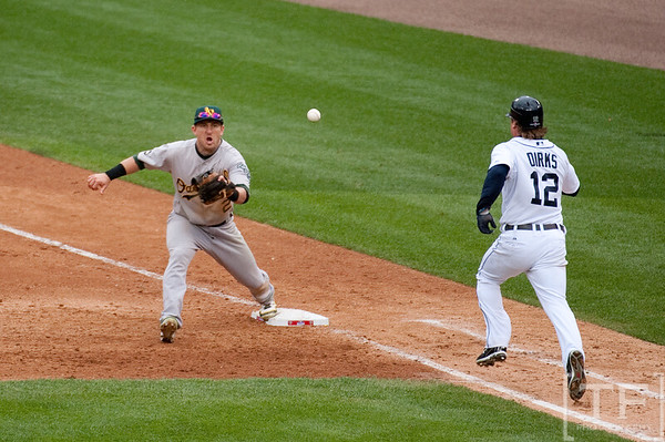 Oct 7, 2012; Detroit, MI, USA; Detroit Tigers left fielder Andy Dirks (12) is forced out by Oakland Athletics shortstop Cliff Pennington (2) during the eighth inning of game two of the 2012 ALDS at Comerica Park.  Mandatory Credit: Tim Fuller-US PRESSWIRE