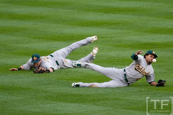 Oct 7, 2012; Detroit, MI, USA; Oakland Athletics center fielder Coco Crisp (4) is unable to make a catch in center field during the seventh inning of game two of the 2012 ALDS against the Detroit Tigers at Comerica Park.  Mandatory Credit: Tim Fuller-US PRESSWIRE