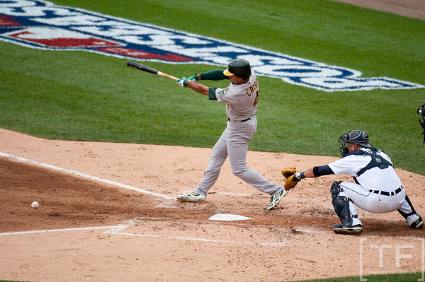 Oct 7, 2012; Detroit, MI, USA; Oakland Athletics center fielder Coco Crisp (4) hits a single during the third inning of game two of the 2012 ALDS against the Detroit Tigers at Comerica Park.  Mandatory Credit: Tim Fuller-US PRESSWIRE