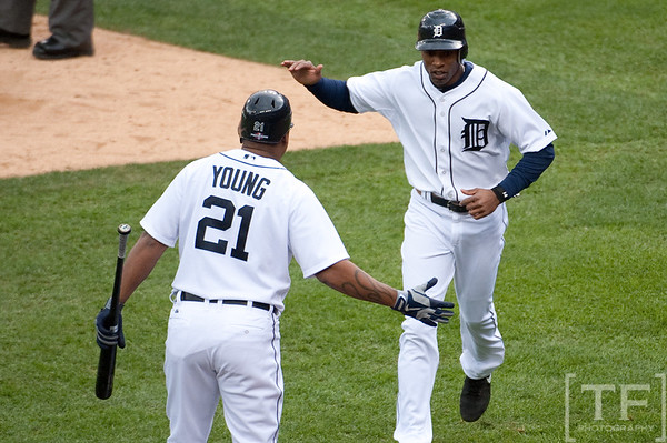 Oct 7, 2012; Detroit, MI, USA; Detroit Tigers designated hitter Delmon Young (21) and Detroit Tigers center fielder Austin Jackson (14) celebrate during the seventh inning of game two of the 2012 ALDS against the Oakland Athletics at Comerica Park.  Mandatory Credit: Tim Fuller-US PRESSWIRE