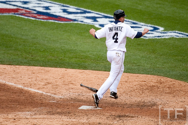 Oct 7, 2012; Detroit, MI, USA; Detroit Tigers second baseman Omar Infante (4) scores the game winning run after a sacrifice fly by right fielder Don Kelly (not pictured) during the ninth inning of game two of the 2012 ALDS against the Oakland Athletics at Comerica Park.  Mandatory Credit: Tim Fuller-US PRESSWIRE