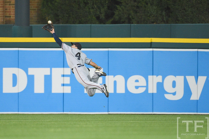 Jul 1, 2017; Detroit, MI, USA; Cleveland Indians center fielder Bradley Zimmer (4) makes a catch during the ninth inning against the Detroit Tigers at Comerica Park. Mandatory Credit: Tim Fuller-USA TODAY Sports