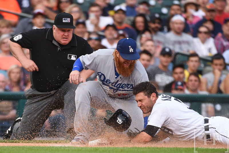 Aug 18, 2017; Detroit, MI, USA; Detroit Tigers second baseman Ian Kinsler (3) slides in safely to third base as Los Angeles Dodgers third baseman Justin Turner (10) attempts to make the out during the first inning at Comerica Park. Mandatory Credit: Tim Fuller-USA TODAY Sports