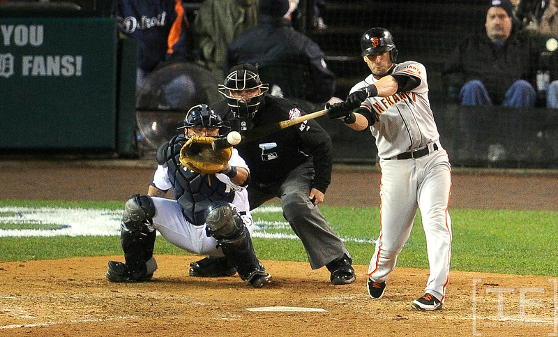 Oct 28, 2012; Detroit, MI, USA; San Francisco Giants second baseman Marco Scutaro hits a RBI single against the Detroit Tigers in the 10th inning during game four of the 2012 World Series at Comerica Park.  The Giants won 4-3 to sweep the series.  Mandatory Credit: Tim Fuller-USA TODAY Sports
